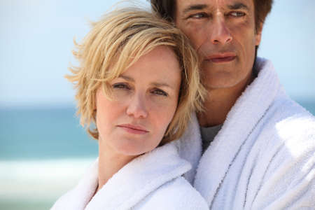dressing gowns: Couple at the beach wearing dressing gowns Stock Photo