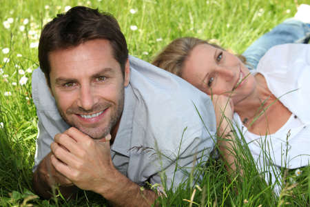 35 39 years: couple in the grass Stock Photo