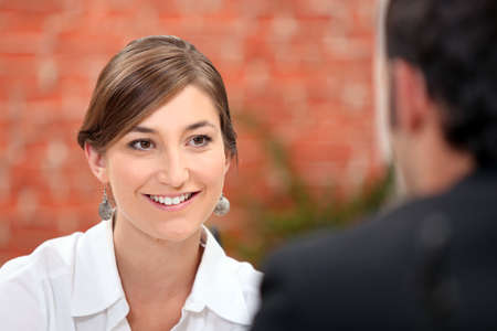interested: Woman smiling at her date Stock Photo