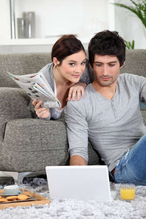Couple relaxing at home Stock Photo - 11135544