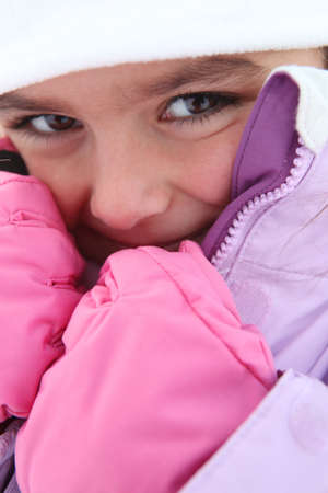 bundles: Young girl in a snowsuit