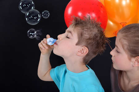 kids making soap bubbles Stock Photo - 11135964