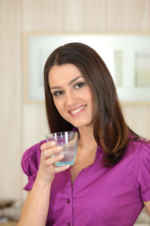 30 35 years women: Attractive woman drinking a glass of water