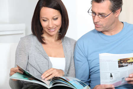 couple reading magazines photo