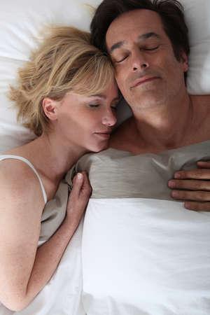man 40 50: Husband and wife sleeping Stock Photo