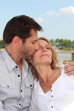 cheek: Husband kissing wife