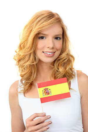 Attractive woman holding a Spanish flag photo