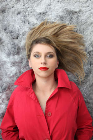 make dirty: Woman in red lying with her hair spread on a rug
