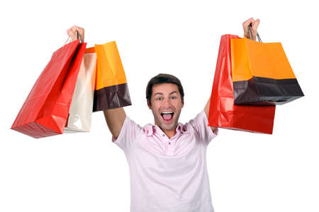 Man holding up shopping bags photo