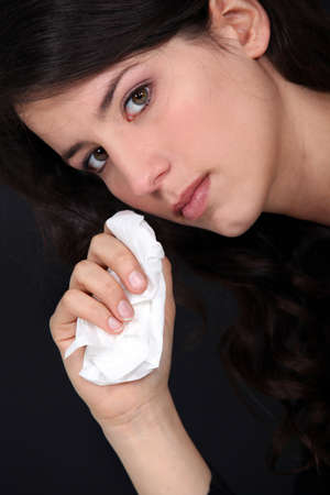 bitterness: woman wiping her tears Stock Photo