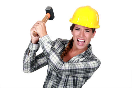 delirious: Woman construction worker getting mad Stock Photo