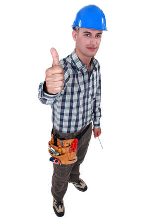 hard work ahead: Tradesman giving the thumb Stock Photo