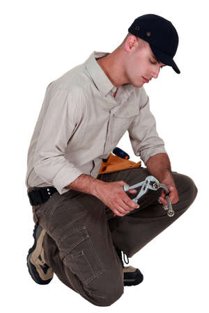 Plumber with a pair of grips Stock Photo - 11135478