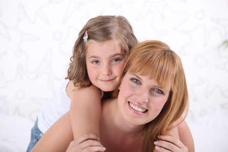 piggy back: Woman carrying daughter on back Stock Photo