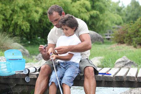 otec: Otec a syn rybaření Reklamní fotografie