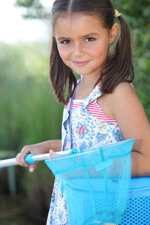 game fish: Young girl with a fishing net