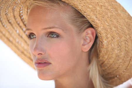 Woman wearing straw hat photo
