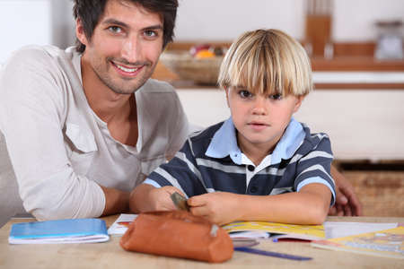 babysitter: Little boy coloring with his father