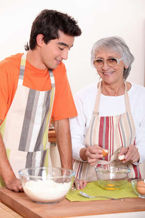 grandmother and grandson cooking together photo