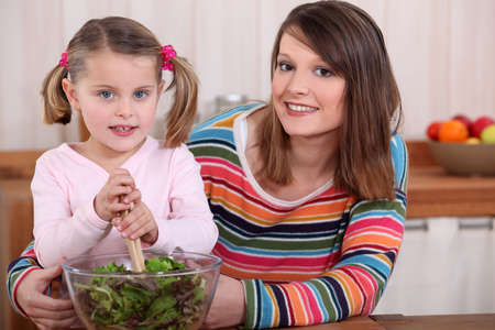 Mother and daughter preparing a salad. Stock Photo - 11135052