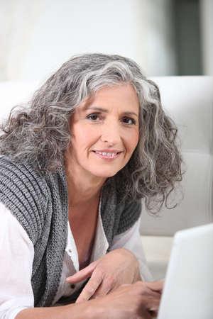Healthy senior woman using laptop Stock Photo - 11135029