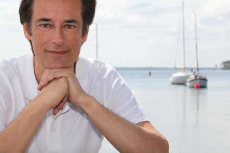 Man smiling by boating lake photo