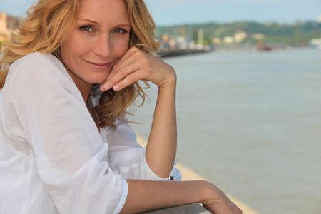 fifty: Portrait of beautiful mature woman outdoors Stock Photo