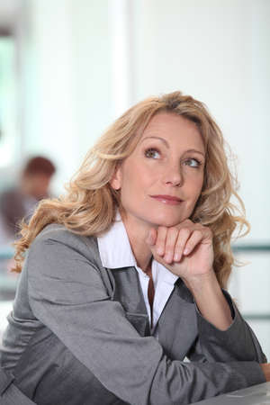 40s adult: Thoughtful businesswoman Stock Photo