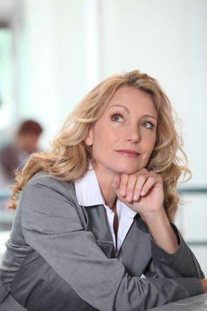 Thoughtful businesswoman photo