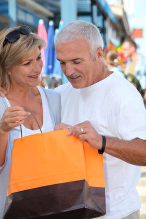 Mature couple looking at a store purchase Stock Photo - 11135226