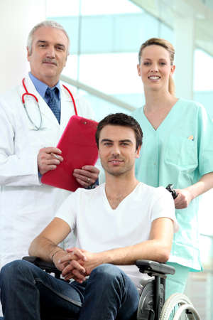 Doctor and nurse with patient in wheelchair Stock Photo - 11135188