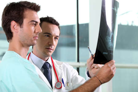 Two medical colleagues looking at x-ray image Stock Photo - 11135341