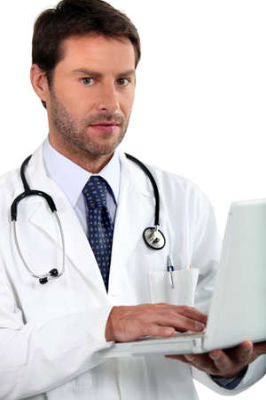 doctor holding laptop photo