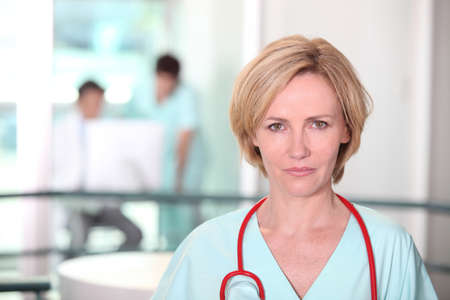 30 34 years: Woman with stethoscope Stock Photo