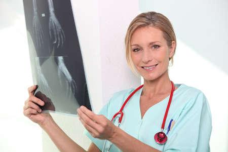 Nurse holding x-ray image of hand Stock Photo - 11135445