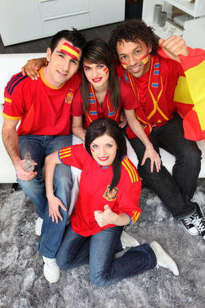sports fans: A group of friends supporting the Spanish football team