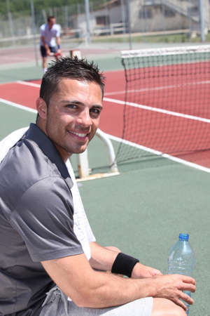 taking a break: Tennis player on the bench