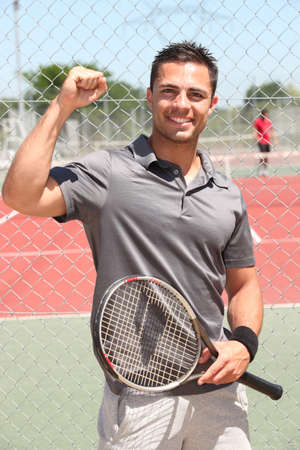 tennis player with racket photo