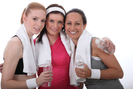 water aerobics: Gym buddies with bottles of water