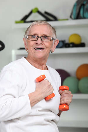 senior woman doing fitness photo