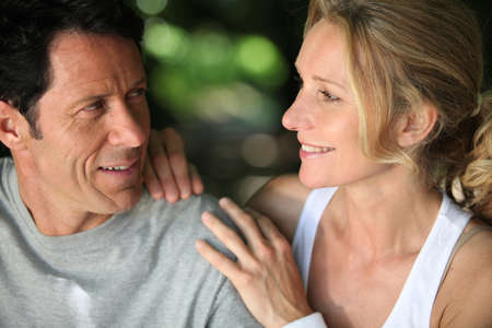 45 49 years: Mature fit couple exercising together in the countryside