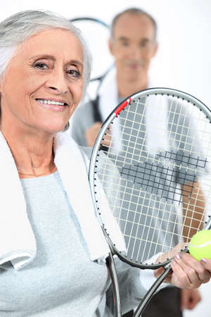Couple playing tennis together photo