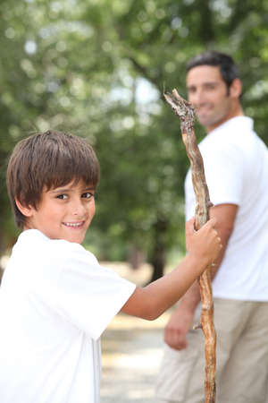 6 9 years: Man out for a walk with his young son Stock Photo