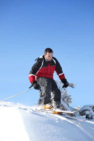 man skiing photo