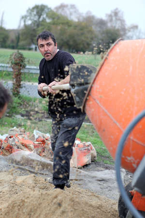 foremaster: craftsmen making cement Stock Photo