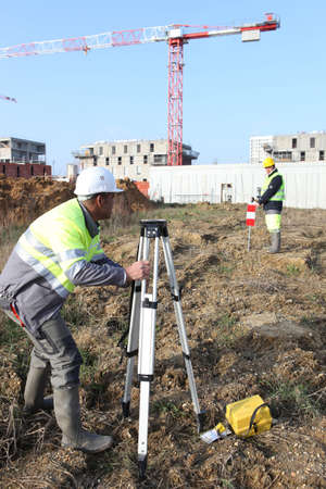 civil: Civil engineers on site with surveying equipment Stock Photo