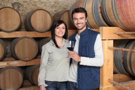 Couple tasting a wine in a winery photo