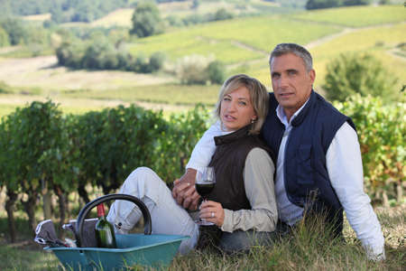 Couple tasting wine in field photo