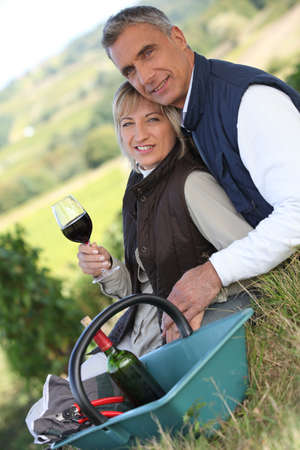 Couple in a vineyard photo