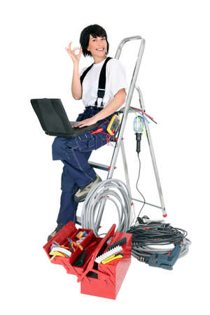 Female electrician with a laptop photo